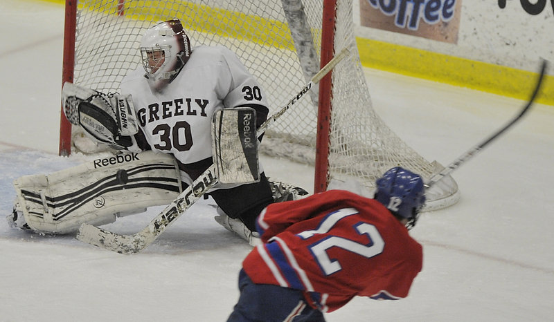 Greely goalie Kyle Kramlich makes one of his 18 saves on the way to a shutout against a Messalonskee team that was averaging six goals per game.