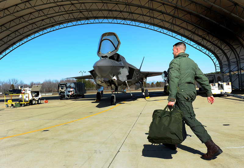 Marine test pilot Maj. Richard Rusnok prepares for a flight in an F-35 at Naval Air Station Patuxent River in Maryland. The plane's design and initial production cost $84 billion.