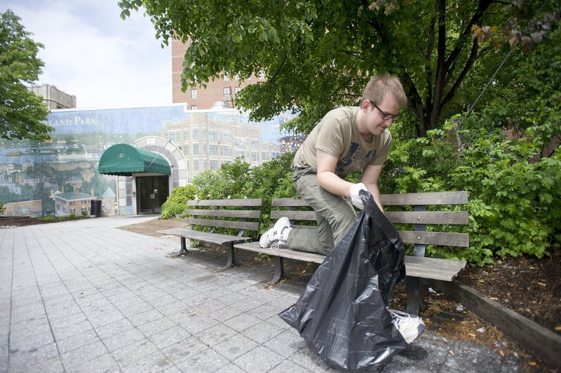 Jake Lowry takes part in an Occupy Maine-organized cleanup of Congress Square Plaza in Portland in 2012. Press Herald coverage of the park repeats unfounded claims of disorderly behavior there, a reader says.
