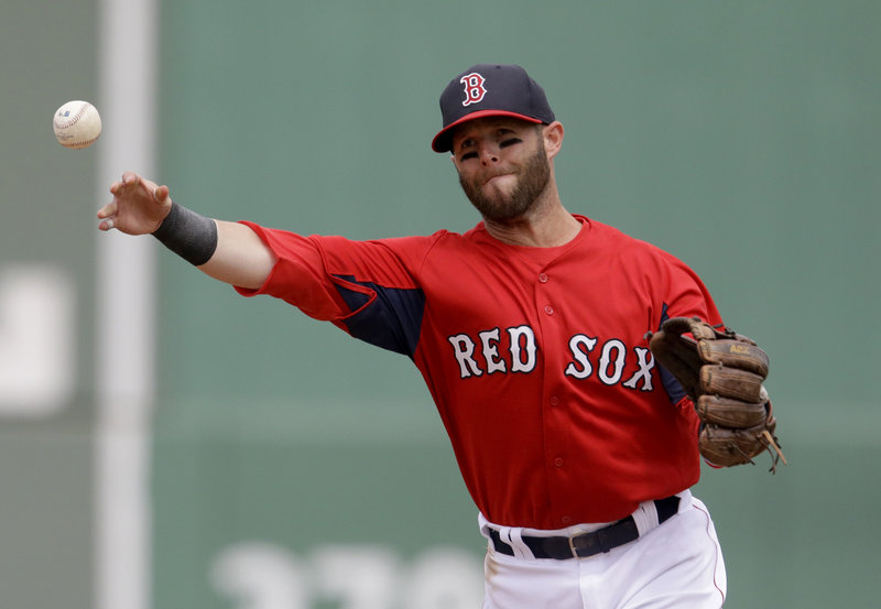 Dustin Pedroia of the Red Sox makes a throw from second in Tuesday's game against Toronto at Fort Myers, Fla.