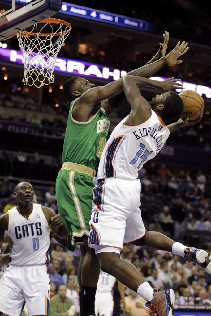 Boston's Jeff Green puts strong defensive pressure on Charlotte's Michael Kidd-Gilchrist during the Bobcats' 100-74 win at Boston on Tuesday night.