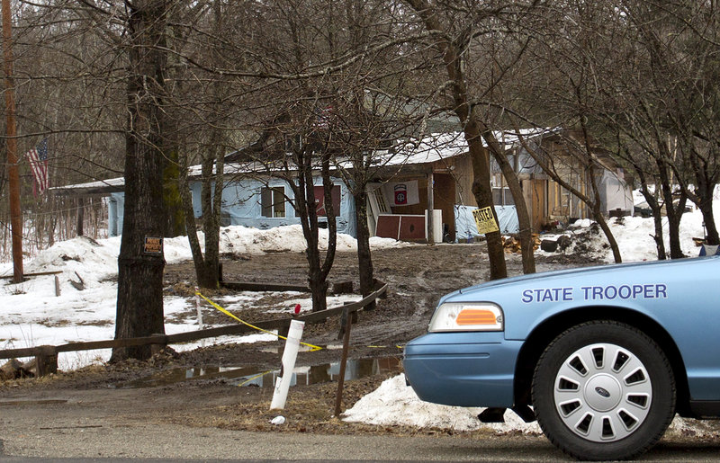 Maine State Police were restricting access Wednesday, March 13, 2013, to the residence at 450 Macwahoc Road (Route 2) in Molunkus Township, where investigators found the body of Lawrence Lewis, who was the victim of a homicide.
