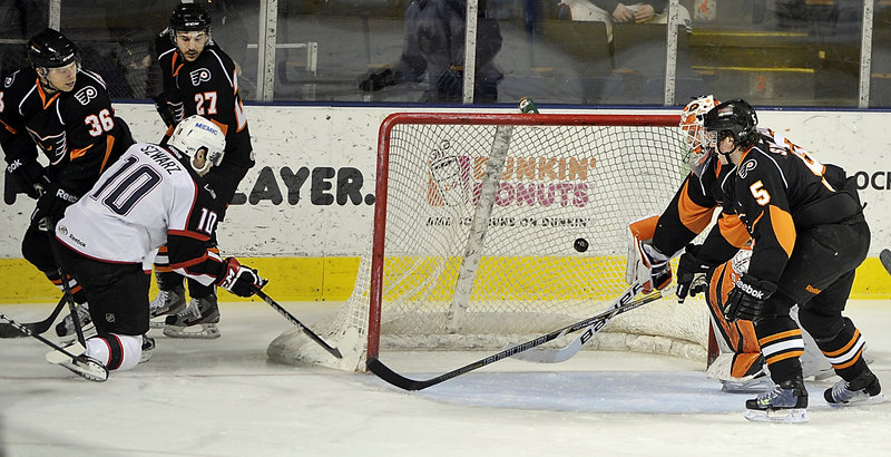 Jordan Szwarz doesn't miss an open net as he gives the Pirates a 1-0 lead Wednesday against the Adirondack Phantoms in Portland.