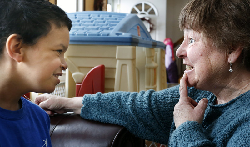 Shavar smiles as his nurse, Darlene Hayden, shows him her teeth after she returned from the dentist.