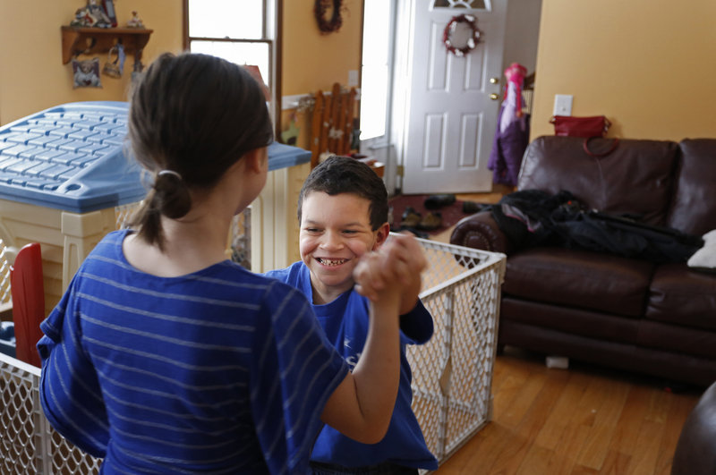 Shavar dances with his sister.