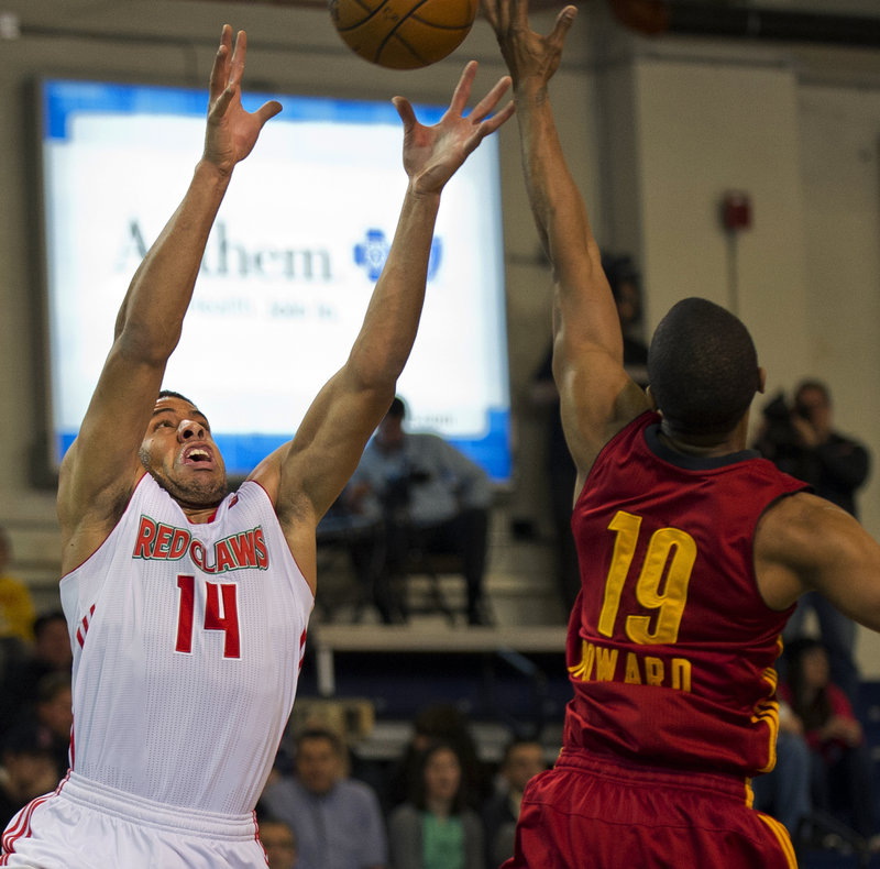 Maine's Mark Tyndale reaches for a pass while Fort Wayne's Ron Howard defends during first-half action of Thursday's game at the Expo Center, won by the Mad Ants.