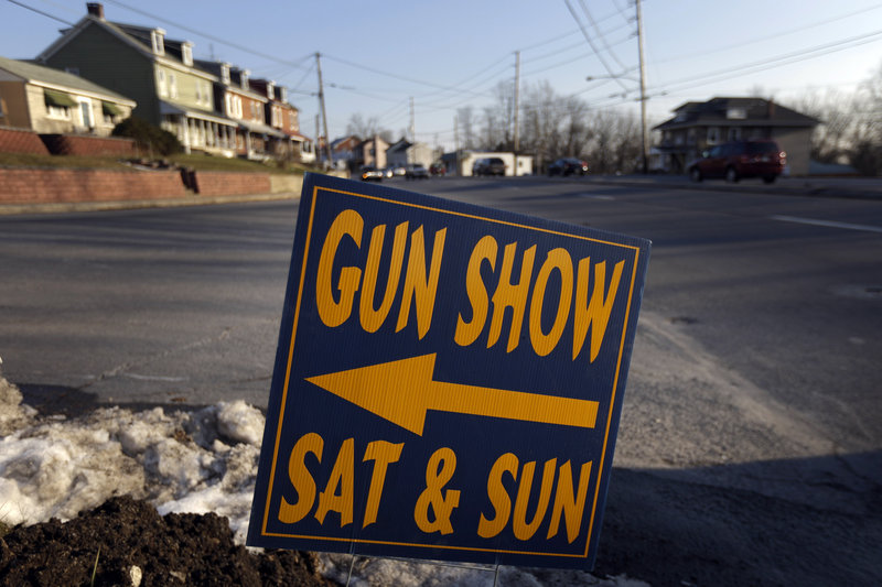 A sign directs visitors to a Leesport, Pa., gun show in a Jan. 4 file photo. A background-check bill will be ineffective if it doesn't call for private sellers to keep records of sales, says the head of the Maine Chiefs of Police Association.