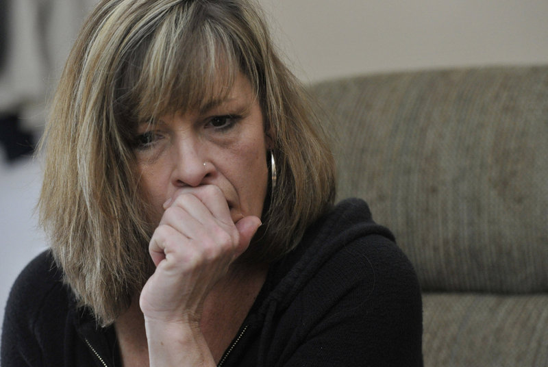 """Laura Schlosser watches a video last week of the 2012 incident involving her son, inmate Paul Schlosser, and Capt. Shawn Welch at the Maine Correctional Center in Windham. """"As a mother, it makes me want to throw up,"""" she said."""