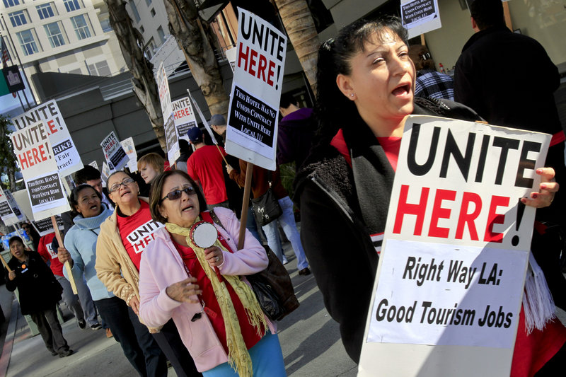 """Hotel workers protest outside a Los Angeles hotel in 2011. Labor organizers who have made little headway using traditional efforts to gain pay increases are finding success with ballot measures that call for a """"living wage."""""""