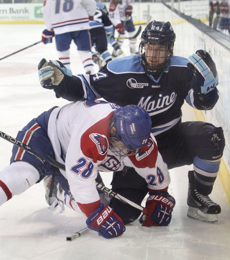 Maine's Mark Anthoine finds himself without a stick as UMass-Lowell's Jake Suter is on top of it while the players clash along the boards during the first period. UMass-Lowell clinched the best-of-three series with its second straight victory, 2-1 in overtime.