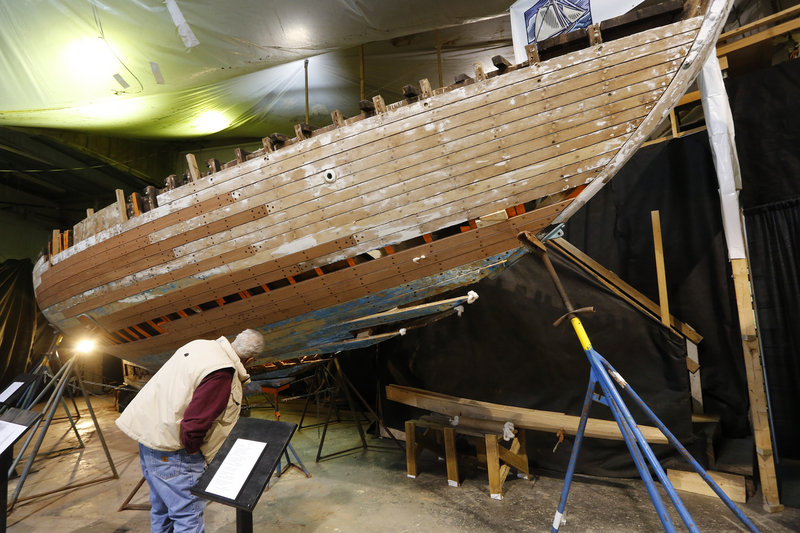 Dan Bossert of Hancock looks at the hull of Blue Heron, a 1934 Sparkman and Stephens Inc. boat, during the 26th annual Maine Boatbuilders Show in Portland.