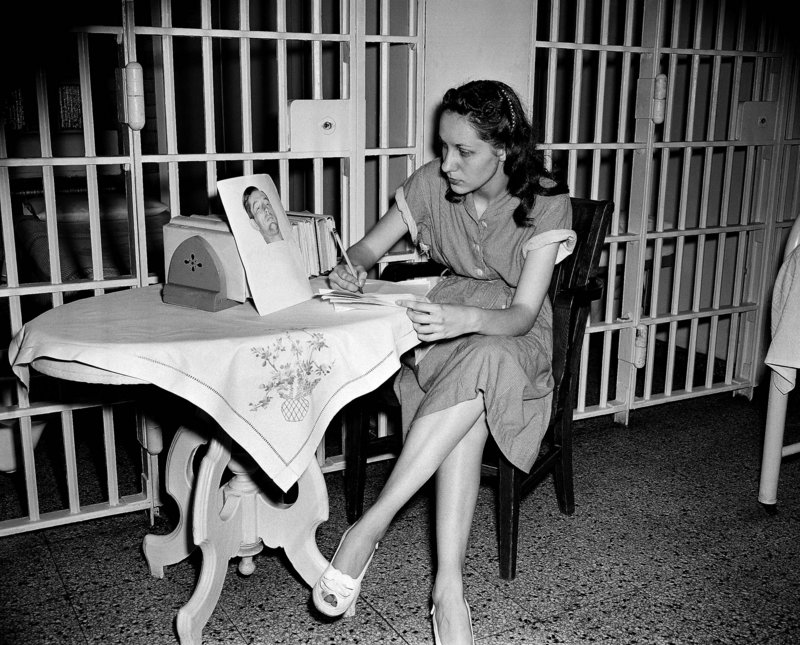 Ruth Steinhagen is shown at age 19, when she was being held at Cook County Jail in Chicago in the shooting of Philadelphia Phillies first baseman Eddie Waitkus at a hotel on June 14, 1949. On the table she has a photograph of Waitkus.