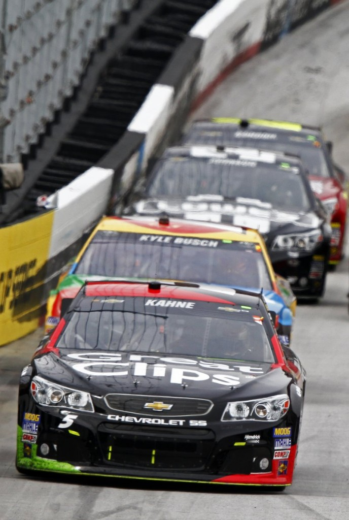 Kasey Kahne's No. 5 Chevrolet leads Kyle Busch at the Food City 500 at the Bristol Motor Speedway in Bristol, Tenn., on Sunday. Kahne won, Busch finished second.