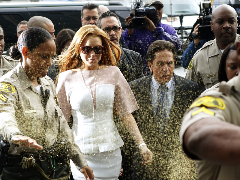 Lindsay Lohan is showered with glitter as she leaves court in Los Angeles on Monday.