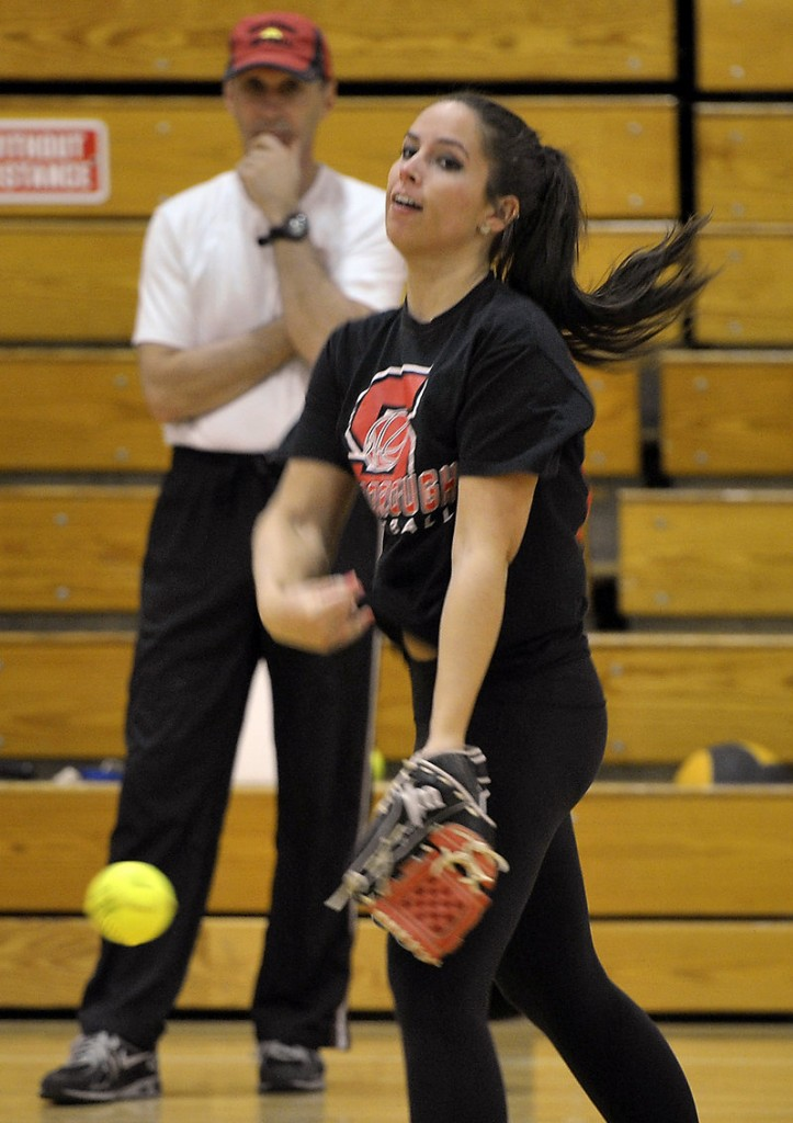 Erin Giles, a senior at Scarborough High, throws a pitch during the first day of spring practice that was held indoors because of the frigid temperature.
