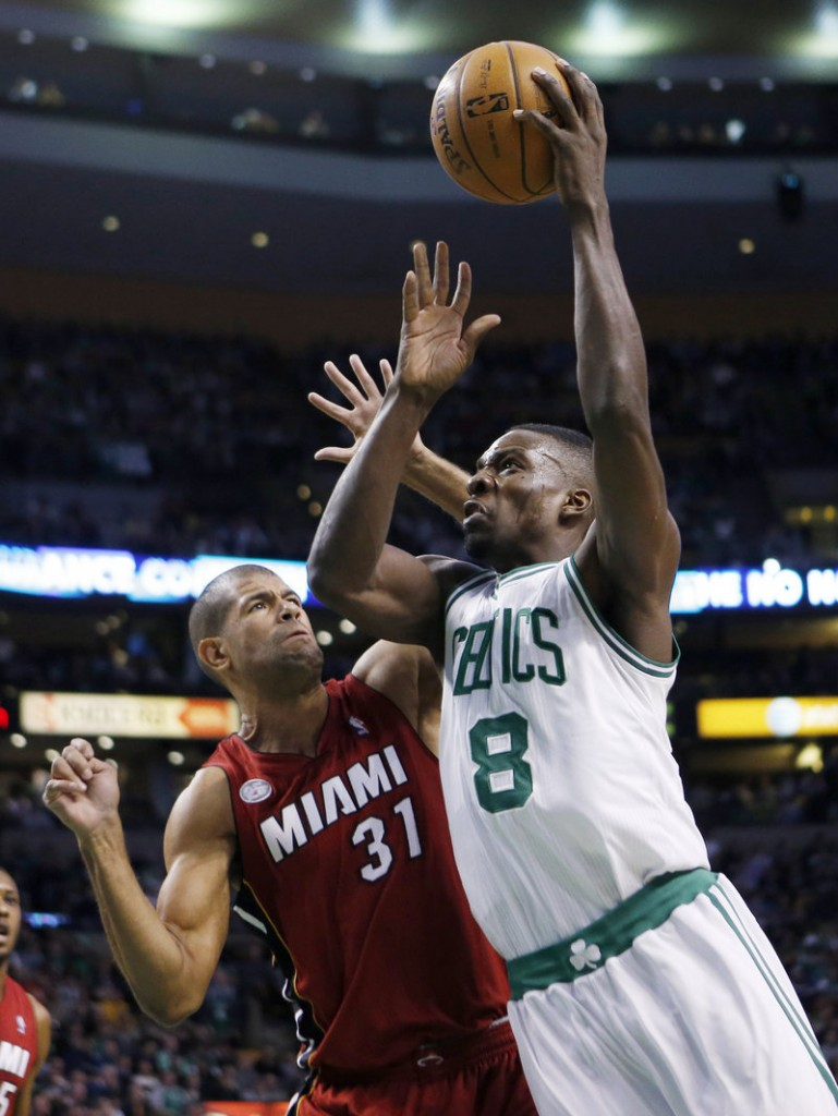 Boston's Jeff Green drives past Miami's Shane Battier during the Heat's 105-103 win at Boston on Monday. Green scored a career-high 43 points.
