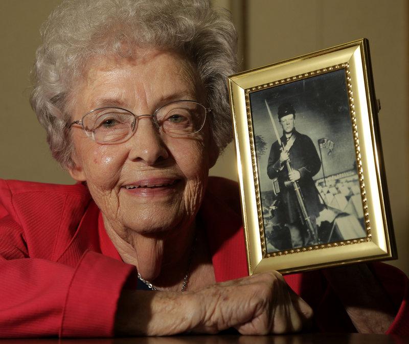 Juanita Tudor Lowrey, 86, holds a photo of her father, Civil War veteran Hugh Tudor. Lowrey received Civil War pension benefits until she was 18.