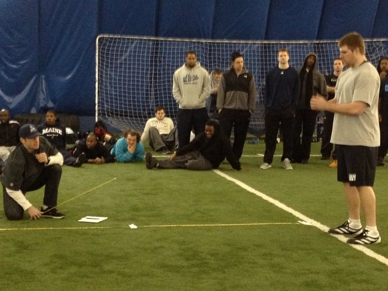 Limington native Josh Spearin prepares for the standing broad jump under the watchful eye of Patriots scout Frank Ross inside at the University of Maine on Wednesday on Pro Day.