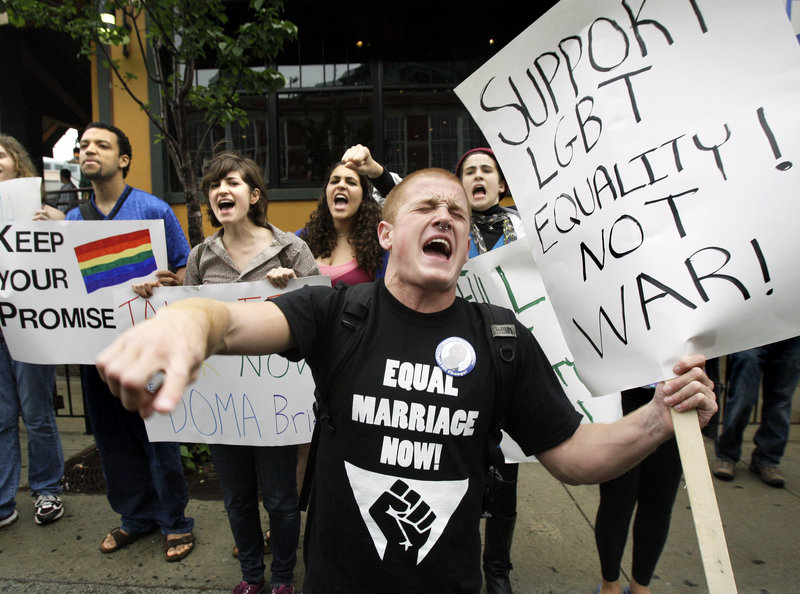 Opponents of DOMA have fought for years to overturn it. Keegan O'Brien of Worcester, Mass., leads chants as members of the LGBT community protest DOMA outside a 2009 Democratic fundraiser featuring Vice President Joe Biden.