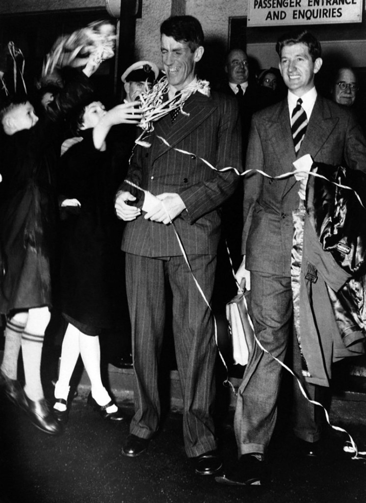 Sir Edmund Hillary, left, and his fellow New Zealander George Lowe are welcomed home to New Zealand in this Aug. 8, 1953, file photo.
