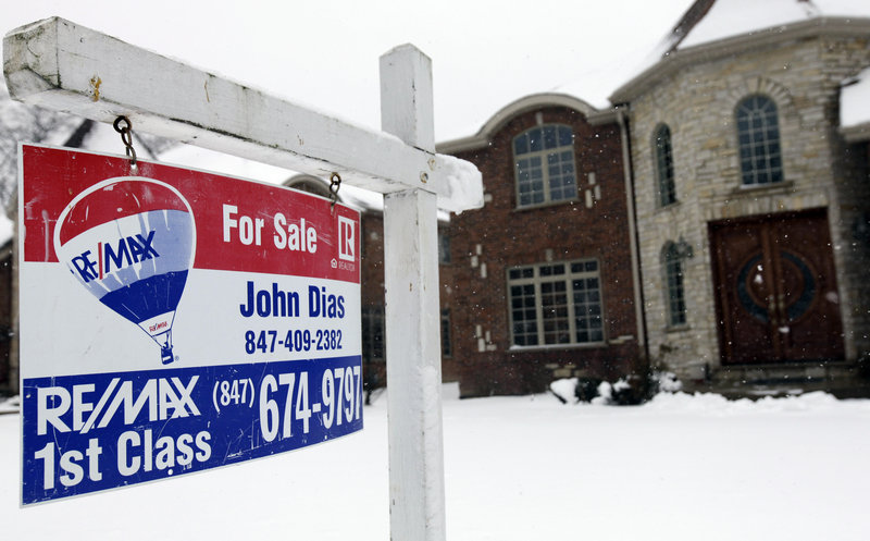 """A """"for sale"""" sign is seen outside a home in Glenview, Ill., last month. U.S. sales of previously occupied homes rose in February to the highest level in more than three years."""