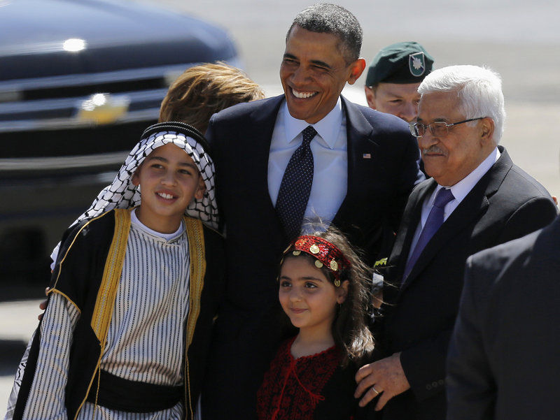 """President Obama and Palestinian President Mahmoud Abbas pose with Palestinian children Thursday after Obama traveled to the West Bank for talks with Palestinian leaders. He urged both sides to shed the """"formulas and habits that have blocked progress for so long."""""""