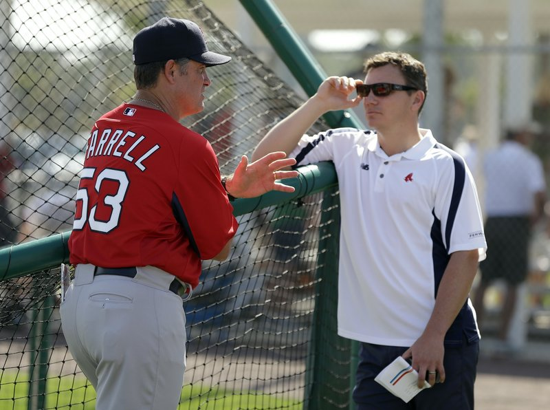 """Red Sox manager John Farrell, left, talks to general manager Ben Cherington after a team workout in Fort Myers, Fla. """"We've had a good spring training,"""" Cherington said."""