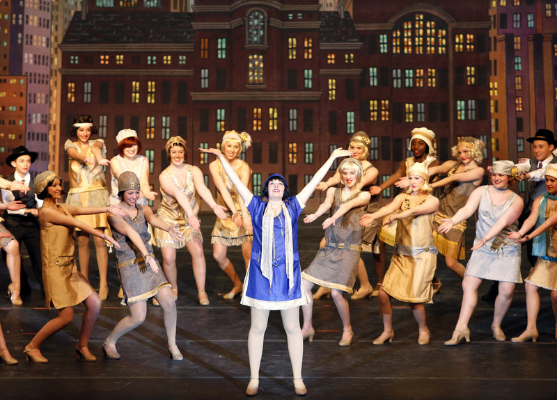 """Paige Doane leads a song during a performance by South Portland High School students of the musical """"Thoroughly Modern Millie"""" on Friday."""