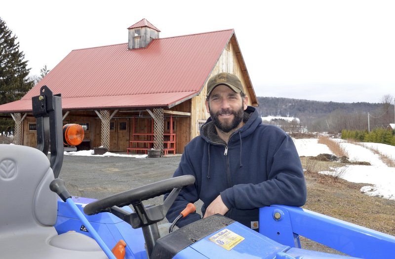 Gideon Porth, owner of Atlas Farm, stands in front of the farm stand in South Deerfield, Mass. Direct marketing is crucial for him and other New England farmers, he says.