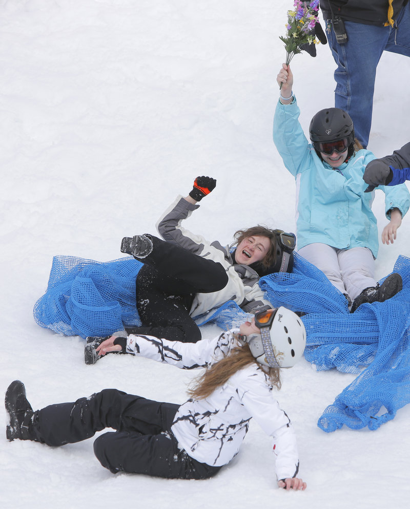 Amy McGurk, Noelle Veillette and Catherine Menousek are all smiles after finishing their run in the Mattress Race at Shawnee Peak in Bridgton on Saturday.