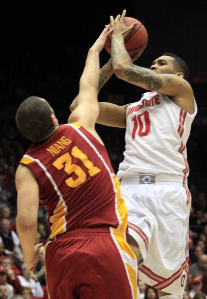 Georges Niang of Iowa State blocks a shot by LaQuinton Ross, but he couldn't stop Aaron Craft's last-second 3-pointer that lifted Ohio State to a 78-75 victory.