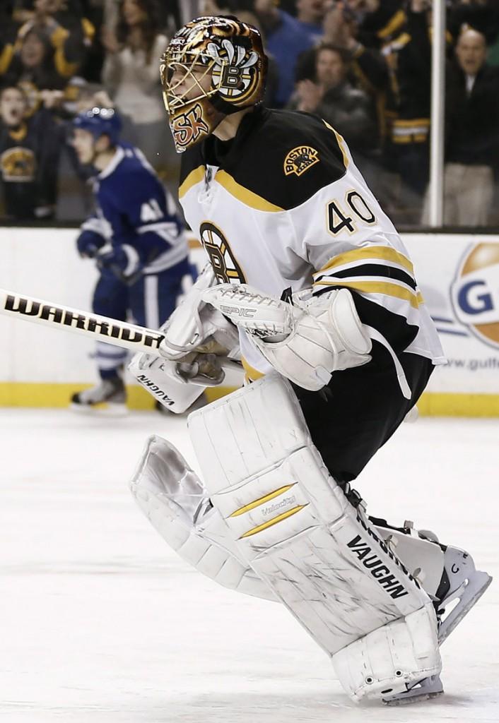 Boston goalie Tuukka Rask celebrates after turning aside Toronto's Nikolai Kulemin's shootout bid to seal the Bruins' victory Monday night.