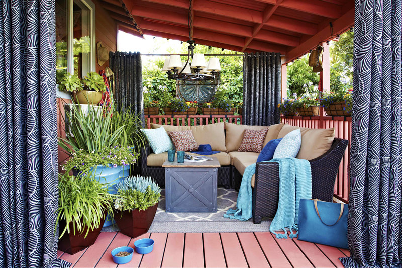 This outdoor living room by Brian Patrick Flynn is arranged around an outdoor chandelier. Flynn often uses chandeliers in covered outdoor spaces to give them the feel of a homey, indoor room.