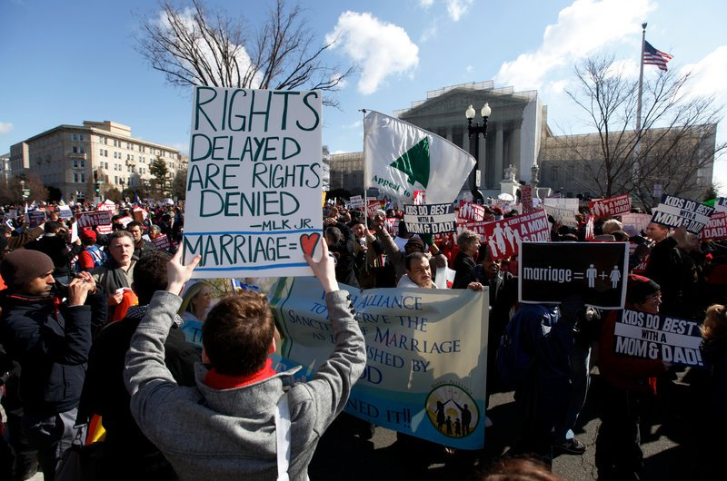 Demonstrators gather Tuesday outside the U.S. Supreme Court in Washington as justices hear arguments on the constitutionality of California's Proposition 8, which prohibits same-sex marriage.