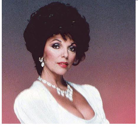 """Joan Collins of """"Dynasty"""" fame models shoulder pads."""