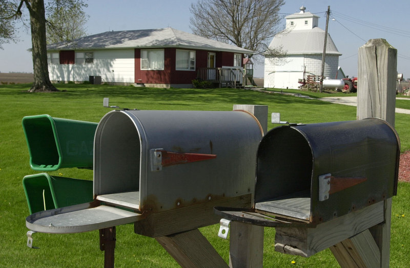 The Postal Service's lack of investment in facilities to handle parcels – not the cost of delivery to rural mailboxes, such as these outside Morrison, Ill. – is the reason it's losing money, a reader says.