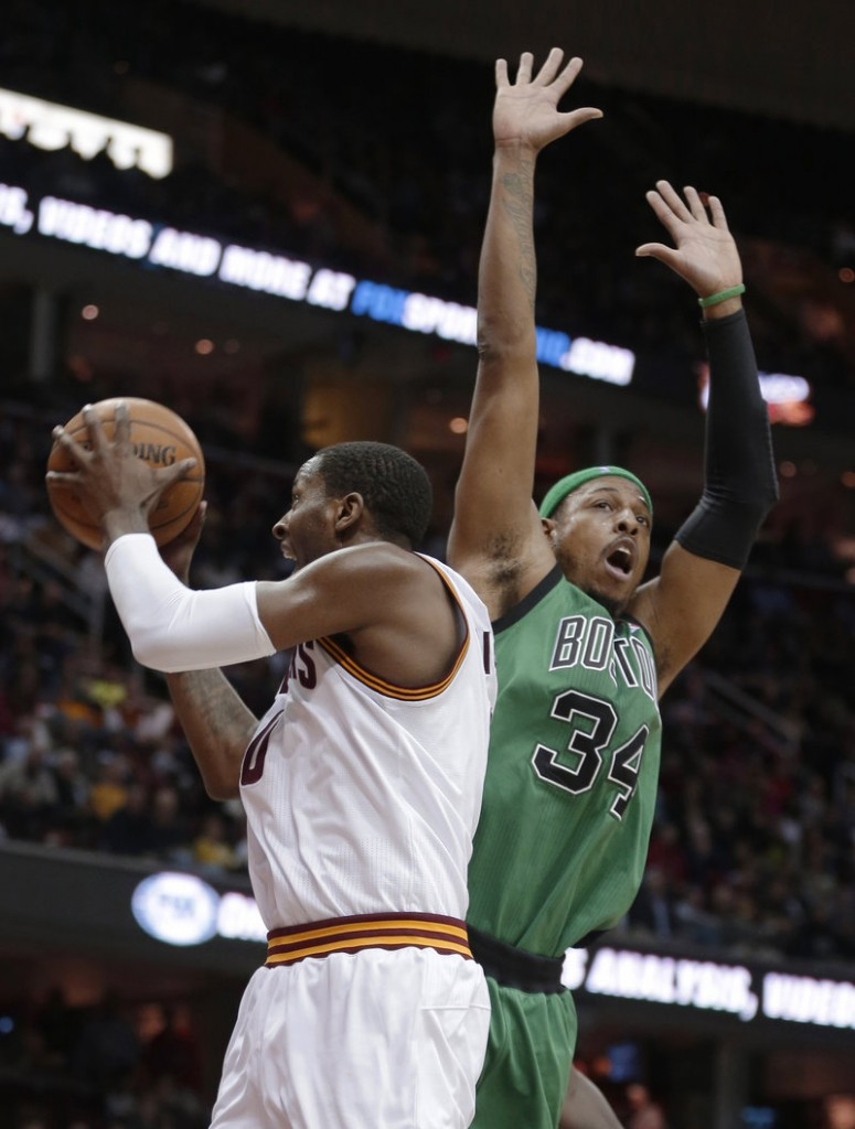 C.J. Miles of the Cleveland Cavaliers controls the ball Wednesday night in front of Paul Pierce of the Boston Celtics during Boston's 93-92 victory.