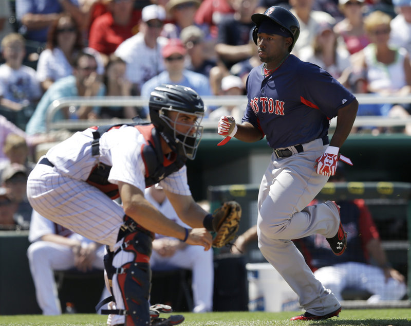 Jackie Bradley Jr. scores on a single by Dustin Pedroia as Minnesota catcher Eric Fryer awaits the throw in the sixth inning Friday. The Twins beat the Red Sox, 8-3.