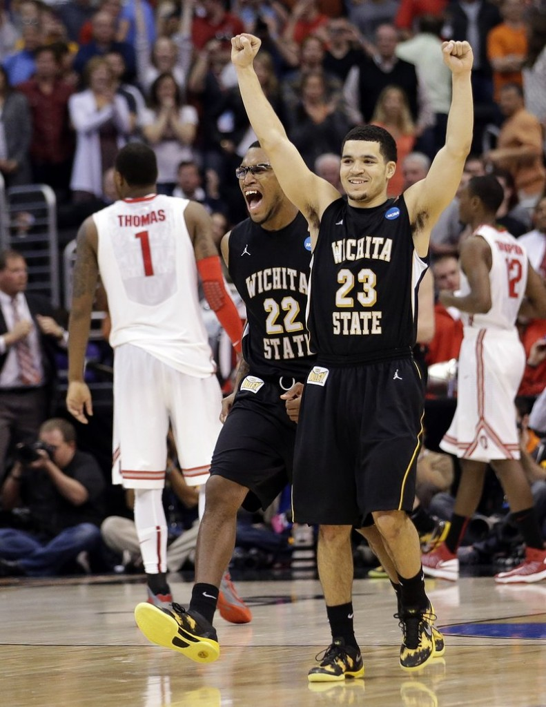 Wichita State's Carl Hall (22) and Fred Van Vleet celebrate their team's 70-66 win over Ohio State in the West Regional final in the NCAA men's college basketball tournament Saturday in Los Angeles. Ohio State's Deshaun Thomas (1) walks off at left.