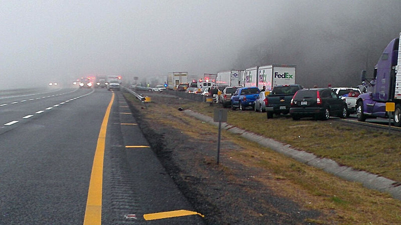 Traffic backs up for about 8 miles Sunday afternoon on Interstate 77 near the Virginia-North Carolina line, following a series of accidents near foggy Fancy Gap Mountain that resulted in the deaths of three people.