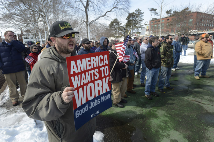 Brett Fralish of Newmarket, N.H., a Portsmouth Naval Shipyard employee, cheers during a demonstration on Thursday in Portsmouth, N.H., against the across-the-board federal spending cuts expected to cause yard workers to lose 20 percent of their pay over the next six months.