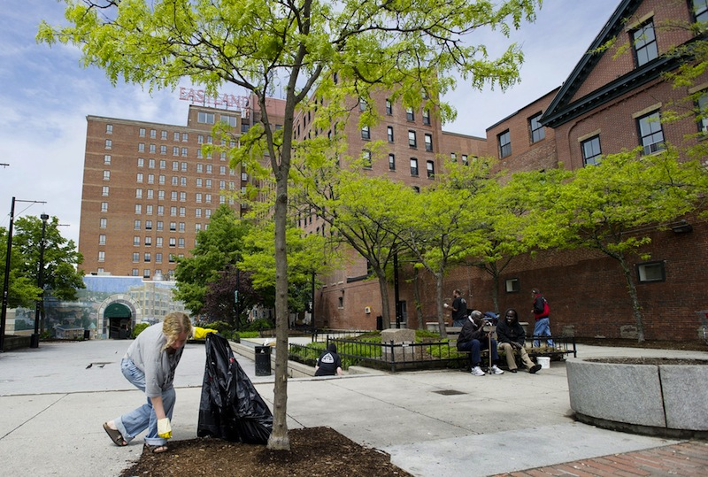 Dawn York of South Portland picks up trash in Congress Square Plaza in this Tuesday, May 22, 2012 file photo. An Ohio hotel developer is working on a new plan to buy a portion of Congress Square Plaza so it can build a facility to host events at the adjacent Eastland Hotel.