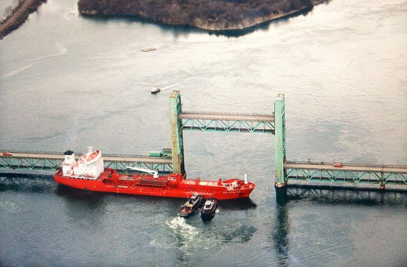 The tanker Harbour Feature sits sideways in the Piscataqua River after hitting the Sarah Mildred Long Bridge between Kittery and Portsmouth, N.H., on Monday.