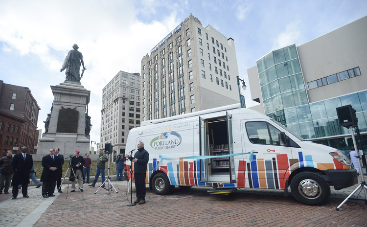 Portland Mayor Michael Brennan speaks during the unveiling of a new Book Mobile Tuesday in Monument Square. The vehicle will increase access to books, technology and education programming for under-served areas of the community.