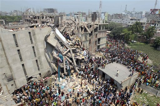 People and rescuers gather after an eight-story building housing several garment factories collapsed in Savar, Bangladesh. Firefighters and soldiers using drilling machines and cranes worked together with local volunteers in the search for other survivors from the building.