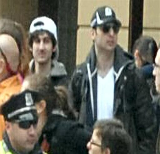 This photo released by the FBI early Friday shows what the suspects together, walking through the crowd in Boston on Monday, April 15, 2013, before the explosions at the Boston Marathon.