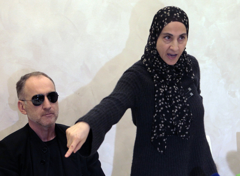 Zubeidat Tsarnaeva, the mother of the two Boston bombing suspects, speaks at a news conference as the suspects' father, Anzor Tsarnaev listens in Makhachkala, in the southern Russian province of Dagestan, on Thursday.