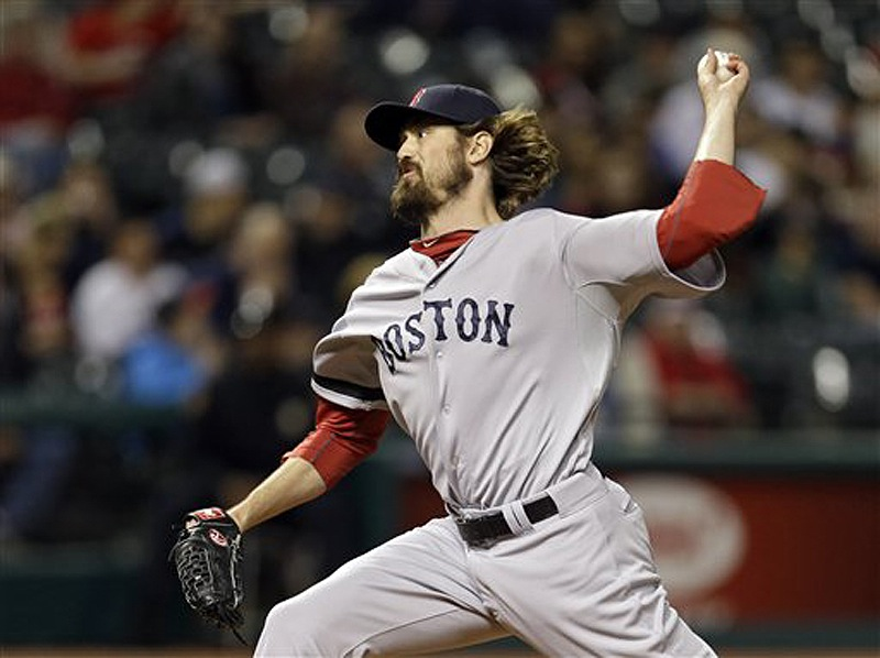 Red Sox relief pitcher Andrew Miller delivers against the Cleveland Indians in the eighth inning Thursday in Cleveland. The Red Sox won 6-3. Progressive Field