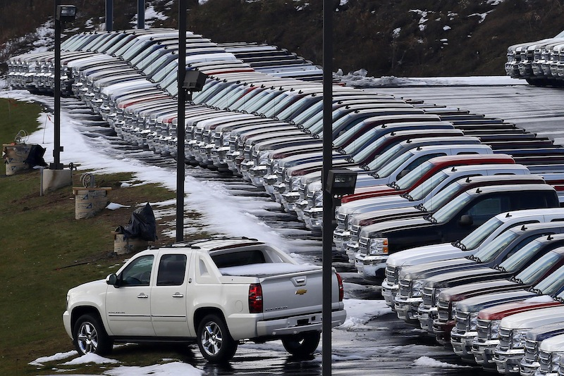 In this Wednesday, Jan. 9, 2013 photo, Chevy trucks line the lot of a dealer in Murrysville, Pa. General Motors announced on Tuesday, April 16, 2013, it plans to roll out a line of completely revamped midsize pickup trucks, with gas mileage and features designed to take sales from Toyota's market-leading Tacoma. (AP Photo/Gene J. Puskar)