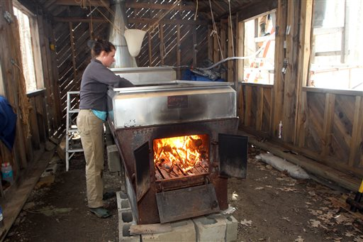 Johanna Lake checks the evaporator March 29 at David Moore's Crooked Chimney sugarhouse in Lee, N.H. Moore, New Hampshire's only known commercial birch syrup producer, got his start in 2008, when he was a student at the University of New Hampshire.